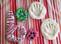 """DIY SALT DOUGH MOLDS...  Ok so yesterday i posted the salt dough recipe under """"kids"""" and said i was doing it w my nephew, well here are a few things we made.. my dos paw prints and his hand printson the website i posted the recipe is :  1 cup of plain flour  1 cup of salt  1/2 c give or take of water  and it said to leave in for 3 hrs at 200F  well after 3 hrs mine were still mushy on the back, i had to leave them in about 8hrs"""