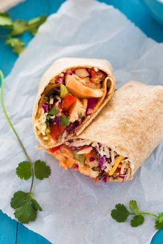 Spicy Thai Chicken Wraps are the perfect meal! Filled with a spicy Thai slaw, grilled chicken, pepper jack cheese & drizzled with Sriracha honey aioli!