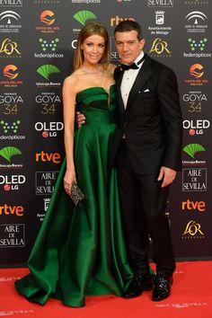 Nicole Kimpel wearing The TE Style 151 dress with Antonio Banderas at  #Goya2020 red carpet. #Pronovias2021 #Pronovias #PronoviasRedCarpet