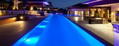 http://www.detecting-in-england.com/wp-content/uploads/2015/10/captivating-home-interior-design-with-upholstered-blue-swimming-pool-lights-along-the-edge-overlooking-with-lounge-chairs.jpg