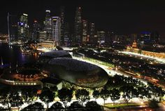 """interstate:    Asian cities (this is Singapore) are just plain cooler looking than Western ones. And they're going to keep getting cooler.  I like tall skyscrapers - only Chicago and New York really pull them off well in all of """"the West"""".  Click through for some cool pictures of the Singapore Grand Prix, which they ran entirely at night."""