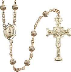 14kt Gold Filled Rosary features 6mm Gold Filled Corregated beads. The Crucifix measures 1 3/4 x 7/8. The centerpiece features a Miraculous medal. Each Rosary i