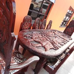 African Hand-crafted Dining set with 2 king chairs and 8 dining chairs made by Mukango Wa Africa with recycled African Strong wood. Please contact us for more information: info@mukango-wa-africa.com