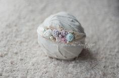 Newborn jersey tieback headband. Headband is embellished with handmade flowers, beads, organic moss.