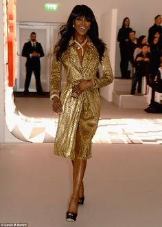 Glittering goddess: Before taking to the runway, Naomi had rocked her glitzy gold trench c...