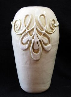 This site has, literally, dozens of surface decoration techniques including carving, slip, glaze application and tons more.