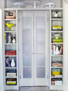 Lacking storage space? How about framing a doorway with shelves?