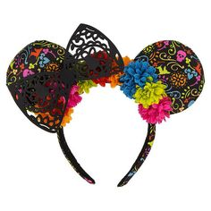 Family times will never be forgotten in Minnie's Dia de los Muertos themed headband with padded, patterned mouse ears, ornate silhouetted bow, and floral decoration.