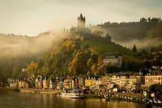 Strokes of autumn morning mist around the beautiful castle of Cochem, Germany. I love the way the castle is elevated from the medieval town . Fantasy Castle, Fairytale Castle, Cochem Germany, Beautiful Castles, Beautiful Places, Germany Castles, Mont Saint Michel, Landscape Wallpaper, Wonders Of The World
