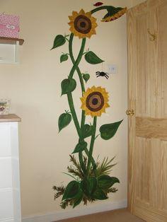 A simple sunflower mural for a nursery.