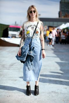 Tyler Broughton does normcore in a Unif tank, midi-length vintage denim skirt, and black ASOS boots.
