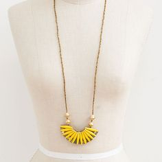 Liven up a basic look with this cheery yellow necklace.