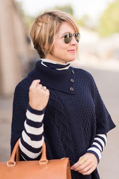Beth of Seersucker + Saddles is loving our navy mixed stitch poncho and we're loving her in it!