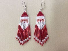 Name: Santa Dangles Beaded Earrings Size: 3 1/4 inches long ( with hooks) 3/4 inch wide Colors: Winter white, red, peach, black. Vintage twisted red bugle beads I have been beading for 20 years and I hope my experience shows through my work. For me, this is soul satisfying work and I hope