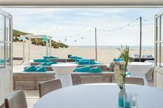 Ibiza aan de Noordzee | Beachclub The Sunset Ameland Beach Club, Ibiza, Dining Table, Table Decorations, Strand, Costa Rica, Shops, Furniture, Home Decor