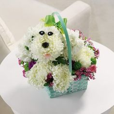 "Or design your own ""doggie"" out of white pomps nestled against other darker flowers. Add google eyes and ribbon for a collar."