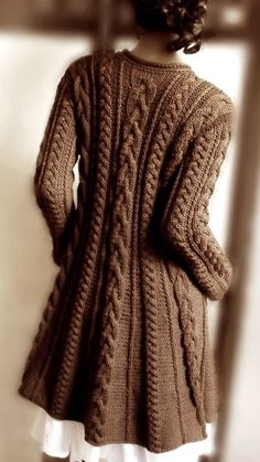 Hand-knit cable sweater in chocolate. Silhouette is a-line. Hand-knit cable sweater in chocolate. Silhouette is a-line. The post Hand-knit cable sweater in chocolate. Merino Wool Sweater, Sweater Coats, Cable Knit Sweaters, Brown Sweater, Sweater Jacket, Chunky Sweaters, Comfy Sweater, Blazer Jacket, Sweater Knitting Patterns
