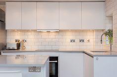 White Handleless Beauformat KItchen in ground floor flat with exposed brickwork