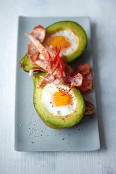 Check out Joe Wicks AKA The Body Coach: eggs baked in avocado recipe