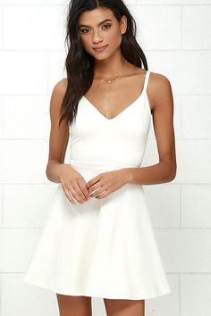 Your future love will never know what hit 'em when you stroll by in the Meet Cute Ivory Skater Dress! Medium-weight stretch knit shapes a darted bodice with a V neckline, supported by skinny straps. Flaring, mini-length skirt. Hidden back zipper.