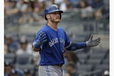The Jays' Josh Donaldson reacts after smashing a solo shot against the Yankees during first-inning action Sunday. Donaldson is putting up numbers that have him in conversations as the AL MVP.