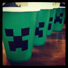 Decorating Minecraft Creeper cups for my son's birthday. lol