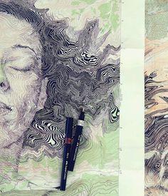 Artista usa mapas como telas para seus desenhos
