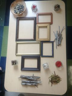 Set up empty picture frames and natural items and encourage kids to create their own images