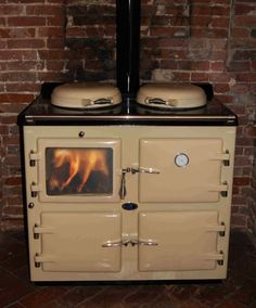 A beautiful 3 Oven Wood Burning AGA Cooker. Would love this one for my future cottage kitchen as well! A beautiful 3 Oven Wood Burning AGA Cooker. Would love this one for my future cottage kitchen as well! Wood Burning Cook Stove, Wood Stove Cooking, Kitchen Stove, Aga Oven, Stove Oven, Oven Range, Aga Cooker, Wood Fuel, Old Stove