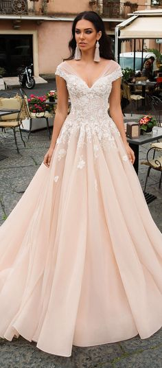 efb71d2e7319 Ball gown wedding dress by Innocentia - Leonarda. Opulence embodied all  over the top and then falls down in the lush rosy tulle princess skirt  blush light.