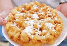 "State Fair Funnel Cakes 3 eggs 1/4 c sugar 2 c milk 3-2/3 c flour 1/2 t salt 2 t bkg pdr Vegetable oil Beat eggs and sugar & add milk. Add dry ingredients and beat until smooth and creamy.   Heat 2"" of oil in a large pot.  Pour batter into a funnel, using  finger to plug hole. Drizzle batter into pan in a swirling pattern.  Brown both sides, & drain on paper towels.  Sprinkle with 10X or cinnamon sugar."