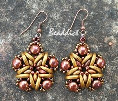 """""""Astra"""" earrings. Designed and beaded by Beaddict. Superduo, crescent, seed beads and two-hole cabochons."""