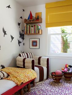 bird wall graphics, club chair, purple rug, yellow roman blinds. what's not to love about this room?? #kidsrooms