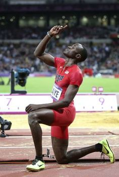 USA's Will Claye pauses and points to the sky after finishing his last attempt in the long jump at Olympic Stadium at the London 2012 Olympics on Saturday, August 4, 2012 in London. Claye finished in third earning a bronze medal.