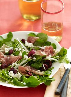A salad of arugula, watercress and mizuna is a spicy foil for fresh cherries, which tame the bracing flavors. Thin slices of prosciutto and handfuls of crumbled goat cheese add a silky, rich taste.