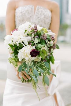 Brides.com: . A bouquet comprised of rich garden florals, shades of blush, lavender and champagne hues, created by Huckleberry Karen Designs.