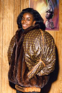 Olympic gold and silver medalist Diane Dixon in jacket by 1980s Harlem Hip Hop tailor Dapper Dan.