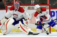 Montreal Canadiens' Brett Lernout (36) clears the puck as teammate Al Montoya(35) looks on during first period preseason NHL hockey action in Ottawa on Saturday, Oct. 1, 2016. (Fred Chartrand/The Canadian Press via AP)
