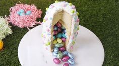 This Candy-Filled Surprise Cake Recipe Has Us Super Excited for Easter  - Delish.com