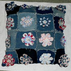 This cushion is made out of recycled denim and embellished with dye cut flowers