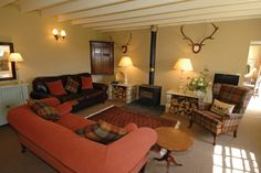 Saddler Cottage, near Cornhill-on-Tweed. An open plan living area with log burner, and logs provided!