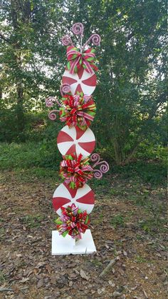 Peppermint Stand Tutorial, Candy Cane Tutorial, Decor Tutorial, DIY Christmas Tutorial, Christmas Decorations This tutorial is to teach you how to make the peppermint stand. The possibilities are endless. Christmas Porch, Simple Christmas, Christmas Holidays, Christmas Wreaths, Christmas Ornaments, Christmas Christmas, Candy Cane Christmas Tree, Christmas Ideas, Primitive Christmas