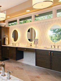Nice back-lit mirrors, vanity, drum shades, floor and wallpaper.... nice overall feel to the room.