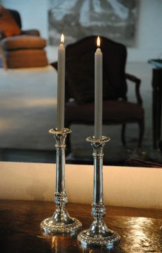 Belgian silver candlesticks, 19th century and accompanying silver candles