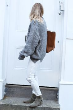 Mija in oversized grey jumper, white skinny jeans, celeing brown shearling tote, isabel marant ankle flat 'ralf' boots