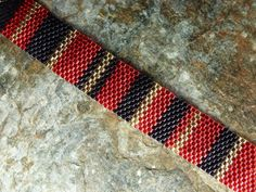 Bracelet in Red Black and Gold by SierraBeader on Etsy, $55.00