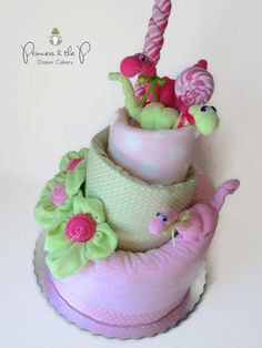 """Dinosaur Topsy Turvy Diaper Cake - I ordered this """"cake"""" for my daughter-in-law's baby shower. It was so well done and incredibly cute!"""