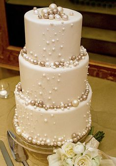 {Bridal Cakes} White 3 tier wedding cake with metallic icing decorative balls #bridal #wedding #weddingcake