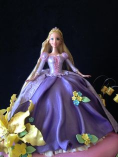 Rapunzel Cake Rapunzel Themed cake from the Disney movie, Tangled. Rapunzel cake top is made with a doll but the gown and bodice is...