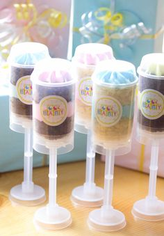 Baby shower push up cake pop idea.  Pink, yellow and blue.  Try it for your next special occasion.